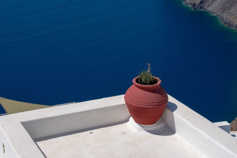 View from a balcony in Santorini Imerovigli Santorini Minimalism EyEmNewHere EyeEm Selects Nature High Angle View Sunlight Potted Plant Water Plant No People Day Growth Shadow Sea Beauty In Nature Blue Cactus Architecture Succulent Plant Outdoors Built Structure Sunny Flower Pot