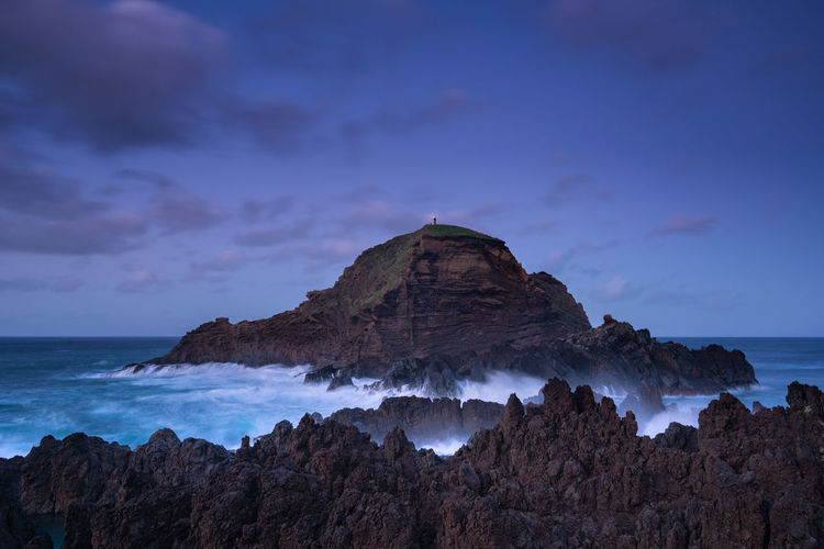 Mole islet landscape in Porto Moniz in Madeira at night Madeira Portugal Island Ilha Travel Landscape Nature Mountain Porto Moniz Panorama Panoramic Rock Water Beach Tranquility Best  Mole Islet Mole Ilhéu Mole Sunset Sunrise Waves Lighthouse Seascape Aerial View