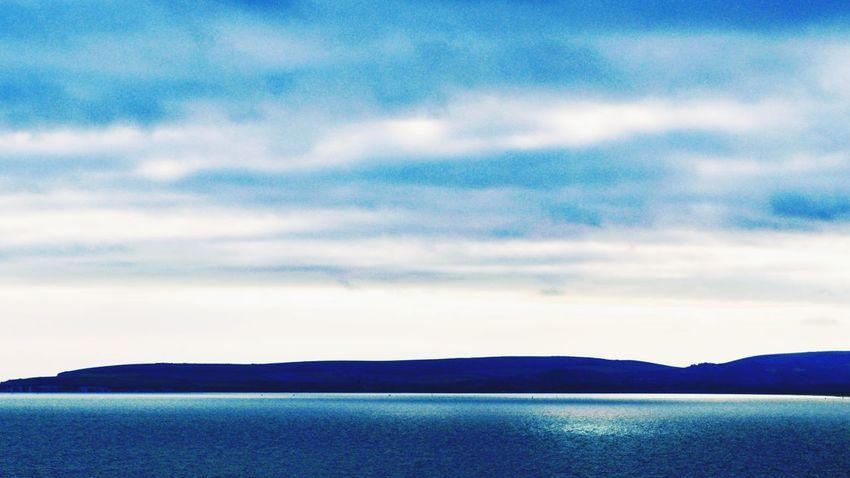 Jurrasic Coastal Photowalktheworld Water Sea Mountain Beauty Blue Sunset Backgrounds Rural Scene Sky Landscape View Into Land Patchwork Landscape Dramatic Sky Horizon Over Water Cloudscape Meteorology Atmospheric Mood Wave Calm Ocean