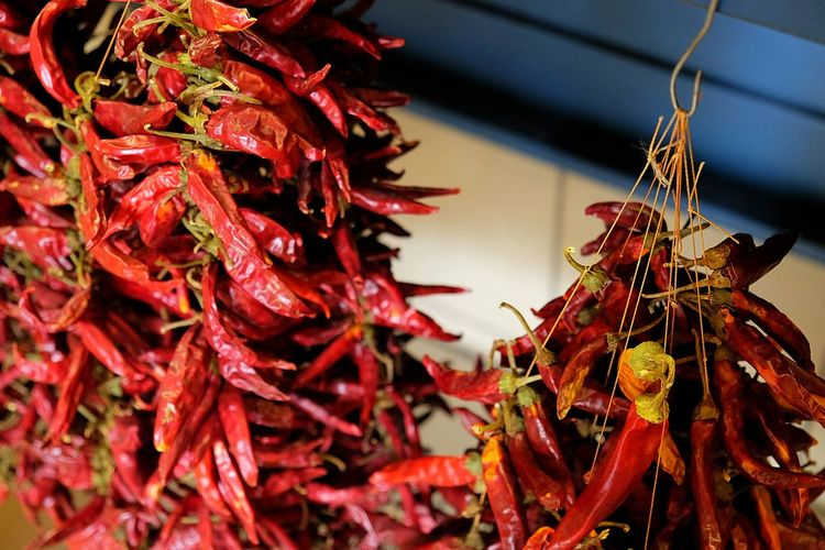 Close-up of dry red chili peppers for sale at street market