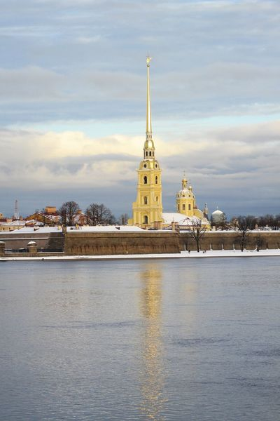 The view of the Peter and Paul Fortress from the Neva river. Cathedral The Week On EyeEm Winter Angel Statue Architecture Building Exterior Built Structure City Cityscape Clock Tower Cloud - Sky Day Fortress Wall History Outdoors Peterandpaulfortress Place Of Worship Reflections Religion Sky Snowy Spirituality Travel Destinations Water Waterfront