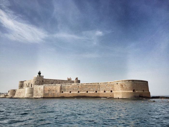 Fort by sea against sky