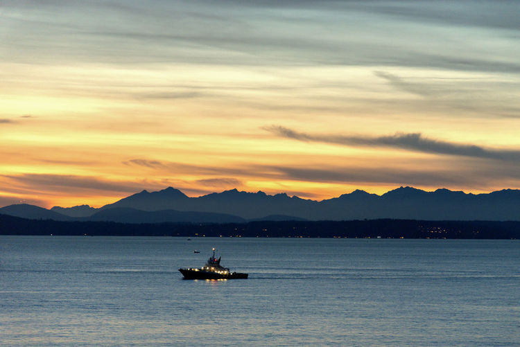 Ship at sunset over Puget sound and the Olympic Mountains. Sunset Olympic Mountains Silhouette Ship Sailing Patrol  Boat Police Military Night Dark Golden Hour Travel Yacht Dusk Seattle Puget Sound Elliott Bay Pacific Northwest