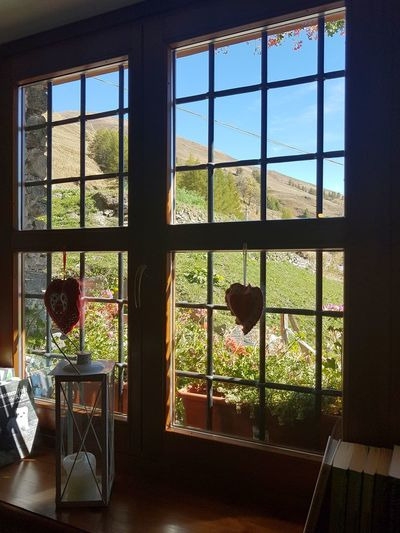 Window View Interior Design Interior Details Looking Out Of The Window Mountain House Interior Window Indoors  Day No People Flower Tree Architecture Sky Nature