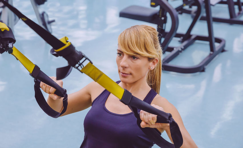 Woman holding resistance band at gym