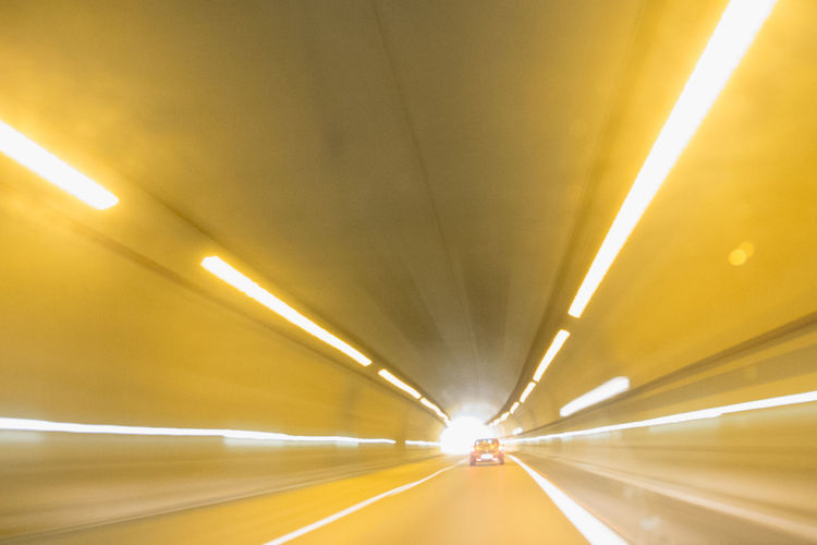 130 Km/h Blurred Motion Diminishing Perspective Illuminated Journey Light Trail Road Speed Taking Pictures Transportation Tunnel Tunnel Vision Yellow Color
