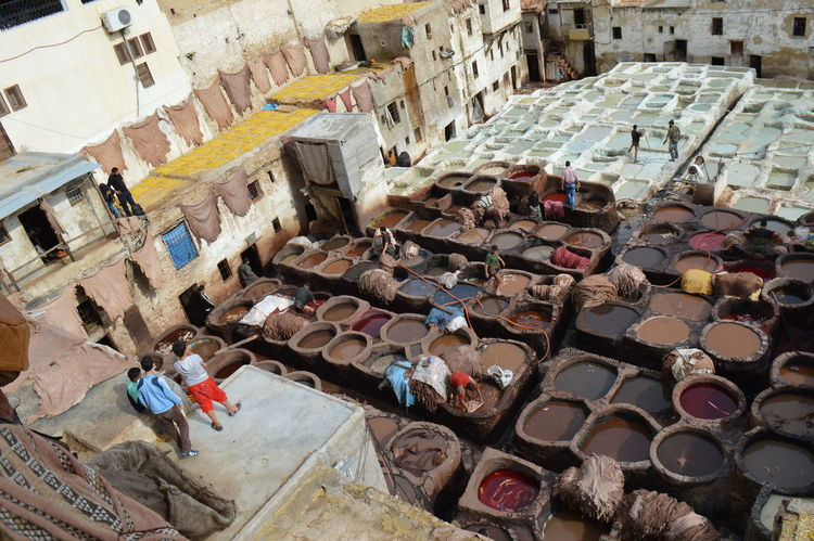 Abandoned Abundance Architecture Building Building Exterior Built Structure City Damaged Day Fes High Angle View Large Group Of Objects Large Group Of People Men Messy Morocco Old Outdoors Person Residential Building Street Tannery