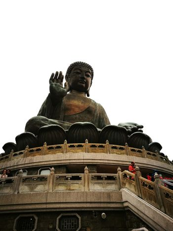 A giant buddha statue at Nong Ping Buddha Temple, Hong Kong Religion Statue Place Of Worship History City Architecture Spirituality Cultures Low Angle View No People Outdoors Day Hong Kong Travel Holiday Trip Landmark