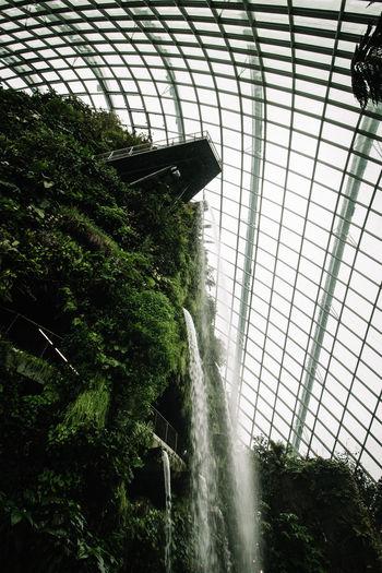 Low angle view of waterfall through window