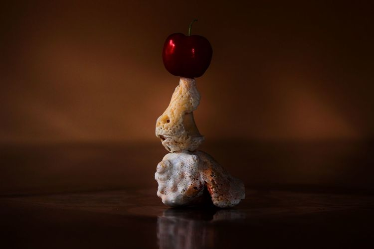 Stack of cherry and seashells on table