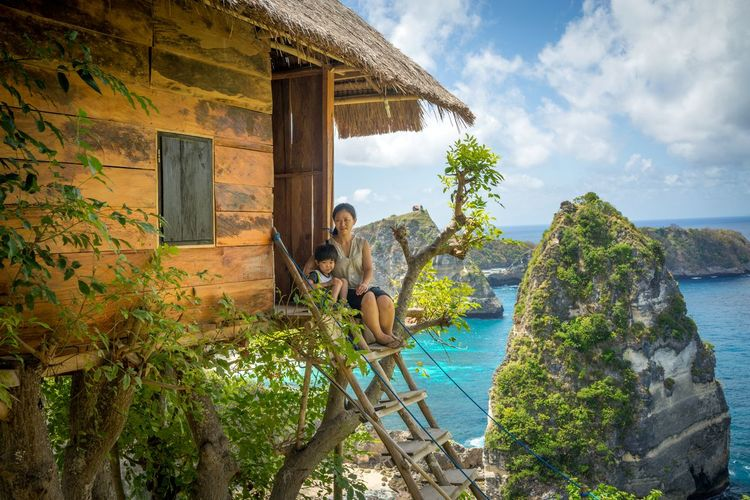 Nusa Penida, Bali Bali INDONESIA Nusa Penida Island Adult Architecture Beauty In Nature Building Building Exterior Built Structure Cloud - Sky Day House Hut Leisure Activity Nature Nusa Penida One Person Outdoors Plant Pulau Seribu Sky Sunlight Tree Water