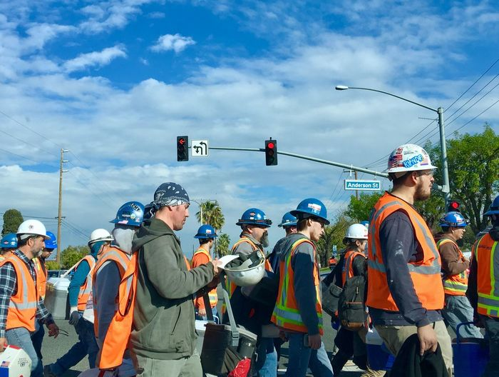 Rush Hour Working Man On The Road Hard Hat Life Humanity Meets Technology Group Of People Cloud - Sky Sky Men Real People Nature Day Architecture Outdoors Occupation Togetherness Streetwise Photography