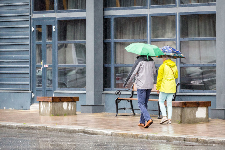 Rain in Tromsø. Adult Adults Only Architecture Building Exterior City Cold Temperature Couple Day Full Length Men Northern Norway Norway Outdoors People Protection Rain Rainy Season Real People Rear View Togetherness Two People Umbrella Weather Wet Women