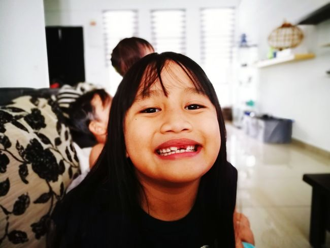 Little girl is ahowing off her missing tooth. Little Girl Girl Asian  Smiling Smile Kid Child Happy Kid Beautiful Girl Teeth Missing Tooth Malaysian Malaysia At Home Funny Funny Faces Asian Girl EyeEm Selects Friendship Smiling Portrait Happiness Cheerful Togetherness City Technology Men Women Selfie Photo Messaging
