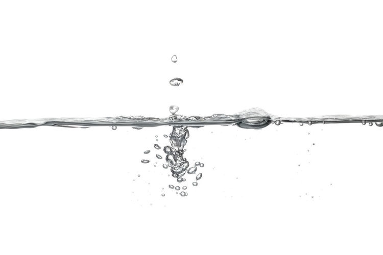 Close-up of water splashing against white background