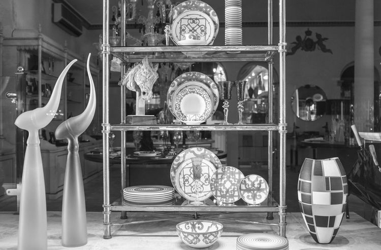 Antique Shop Architectural Feature Arrangement Choice Display Freshness Group Of Objects Indoors  Man Made Object Person Retail  Shelf Variation Window Display Photography Window Shopping