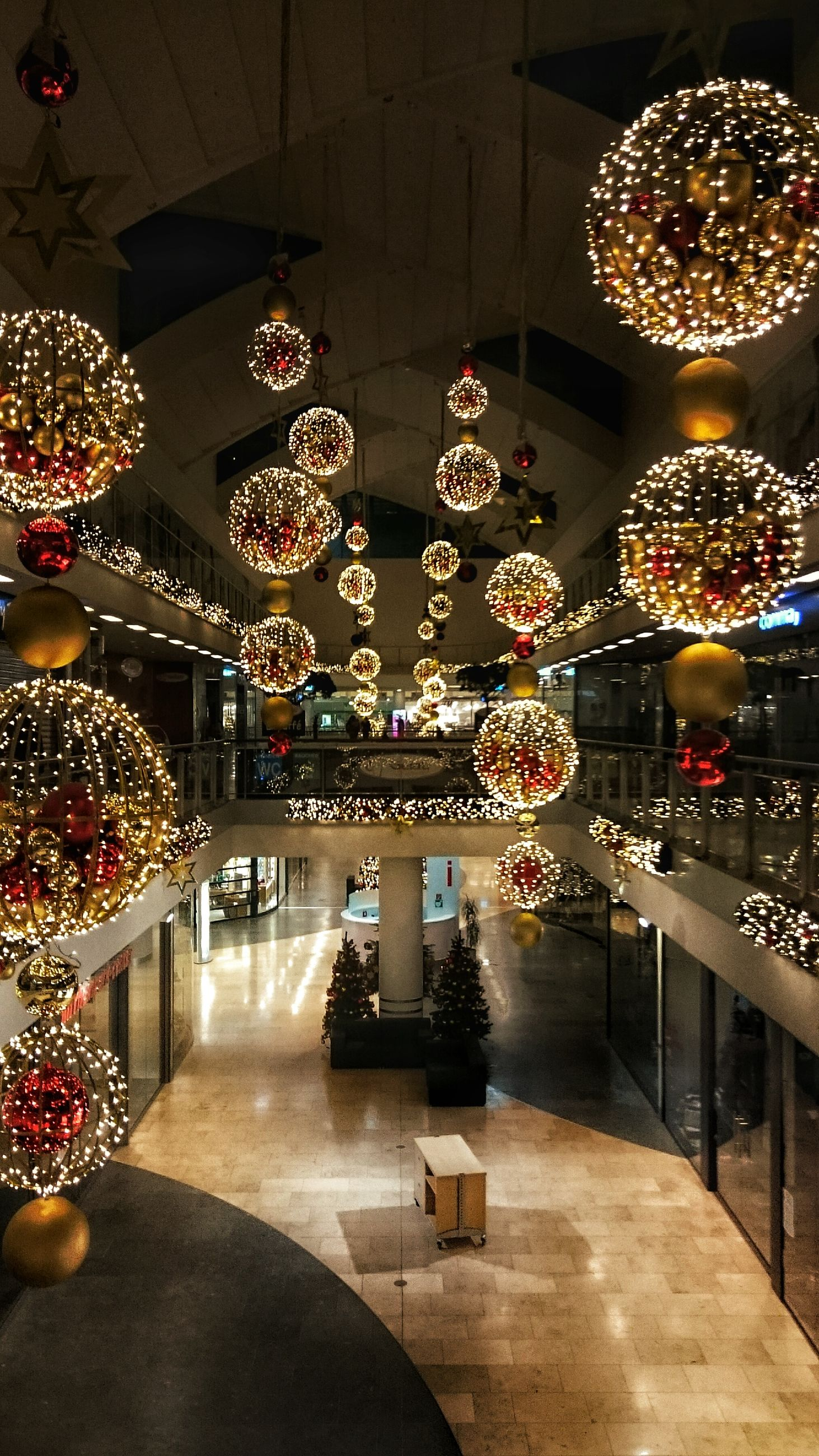 indoors, illuminated, decoration, lighting equipment, chandelier, ceiling, built structure, hanging, night, architecture, decor, electric lamp, table, ornate, christmas decoration, flooring, luxury, lantern, tradition, design