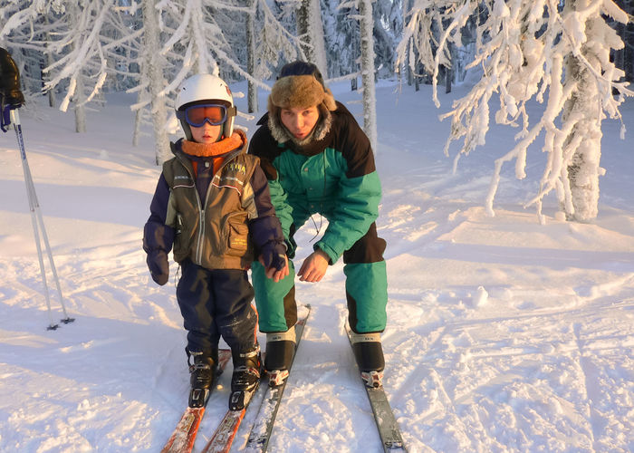 Adult Cold Temperature Day Finland Leisure Activity Outdoors People Ski Holiday Slalom Snow Vacations Warm Clothing Winter Young Boy Snow Sports