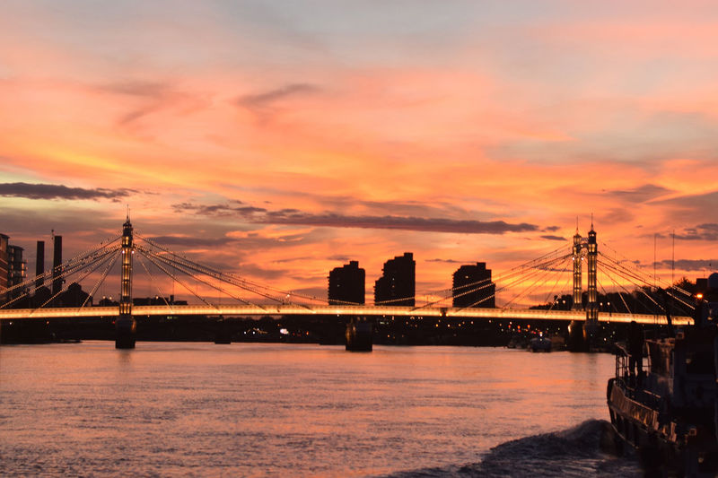 Incredible, mesmerizing, unedited sunset in London Sky Sunset Water Cloud - Sky Transportation Architecture Nature Waterfront Built Structure Orange Color No People Outdoors Connection Bridge Bridge - Man Made Structure River Suspension Bridge Wallpaper Desktop Europe London Nautical Vessel Boat Light Beauty In Nature