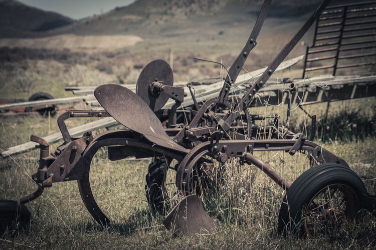 Abandoned motorcycle on field