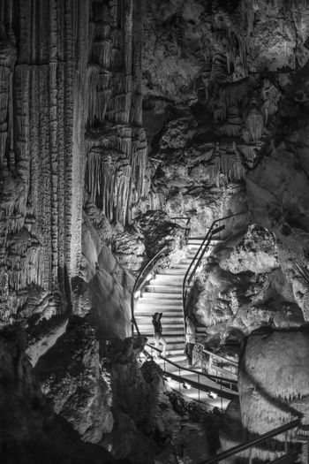 Low Angle View Of Illuminated Staircase In Caves Of Nerja