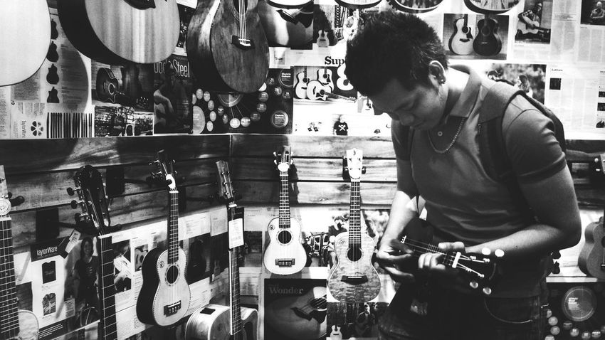 testing Music Guitar Focus On The Story Men Working Store Retail  Business Finance And Industry Display Store Window Window Shopping