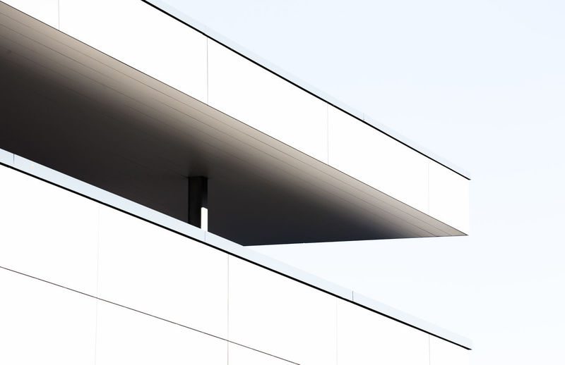 Low angle view of building corner against sky