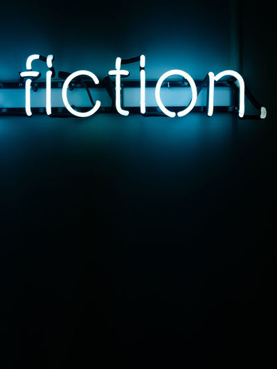 Close-up of illuminated text against black background