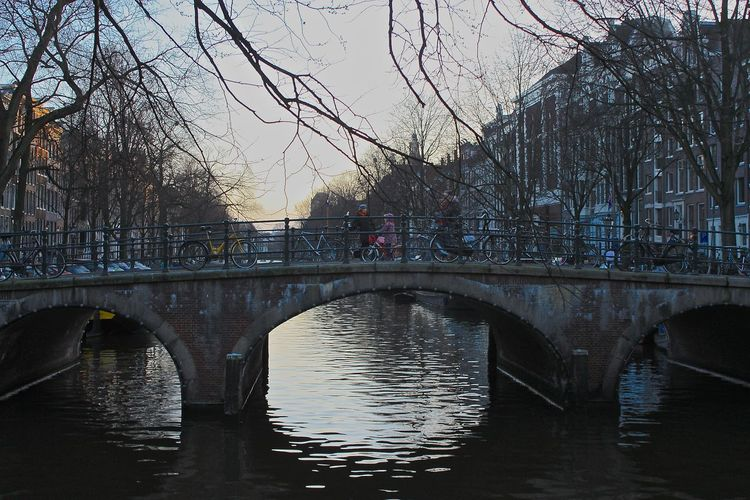 Crossing the bridge. Arch Bridge Architecture Bridge Bridge - Man Made Structure Building Exterior Built Structure Canal Capital Cities  City City Life Connection Crossing Outdoors Reflection River Tourism Transportation Water Waterfront Your Amsterdam
