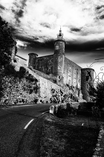 Mairie et ex château de Lussan Architecture Built Structure Building Exterior Direction History Tower Travel Destinations Sky Outdoors Stone Wall Cloud - Sky The Past The Way Forward Historic Day Castle Footpath Historic Building Fortified Wall Cloudy