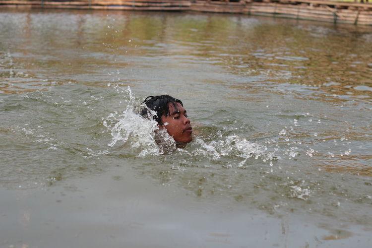Portrait of boy swimming in water