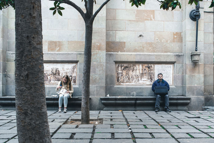 Adult Architecture Barcelona Building Exterior Built Structure Casual Clothing City EyeEm Diversity Full Length Lifestyles Loneliness Lunch Break Old Town Pause People Real People Silent Moment Sitting Two People Young Adult Press For Progress