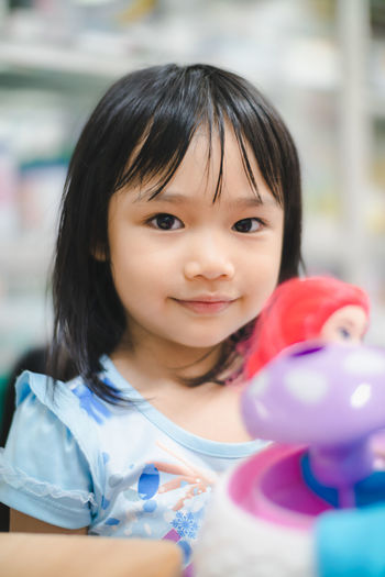 Childhood Portrait Child Headshot Smiling One Person Front View Innocence Girls Happiness Looking At Camera Indoors  Females Emotion Cute Real People Focus On Foreground Women Hairstyle Bangs