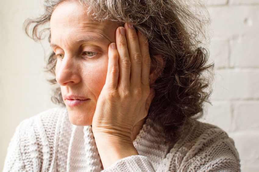 Pensive woman Adult Contemplation Depression - Sadness Emotion Emotional Stress Females Hair Hairstyle Hand Head In Hands Headshot Indoors  Looking Mature Adult One Person Portrait Sadness Senior Adult Serious Uncertainty  Women Worried