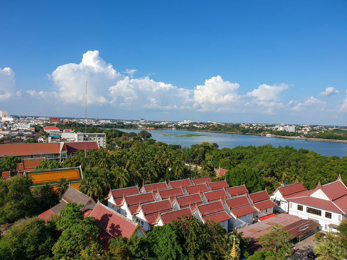 High angle view of houses and buildings against sky
