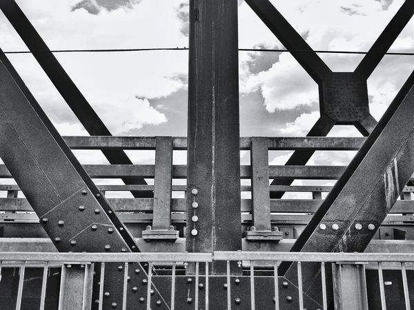 Riveted... Urban Geometry for Bnw_friday_eyeemchallenge Converted Train Bridge Steel Structure  My Cloud Obsession☁️ Discover Your City Learn & Shoot: Single Light Source Deceptively Simple B&w Street Photography My Best Photo 2015 Up Close Street Photography Telling Stories Differently Monochrome Photography Black And White Friday #urbanana: The Urban Playground