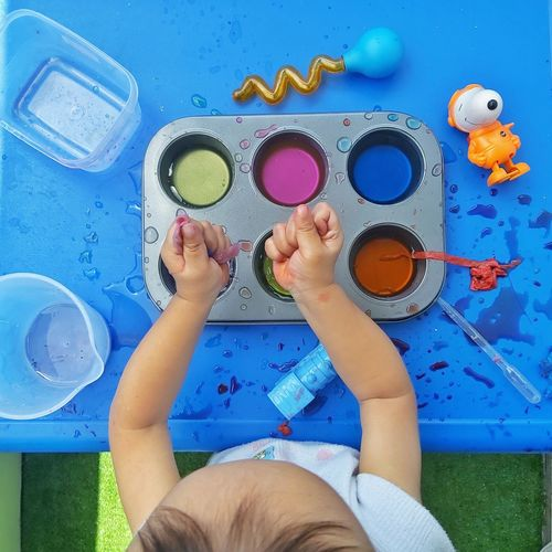 Sensory play with water and paint colours