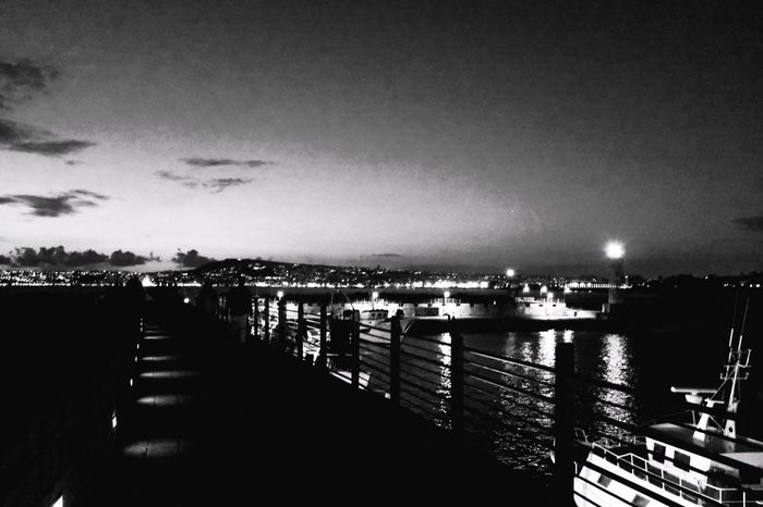 Pier Water Railing Built Structure Sea Outdoors Architecture Harbor Sky Nautical Vessel Vacations Building Exterior Beach No People Day Nature Beauty In Nature City ProvokeCamera Blackandwhite Photography Black And White Photography Black & White Photography Provoke 25600ISO