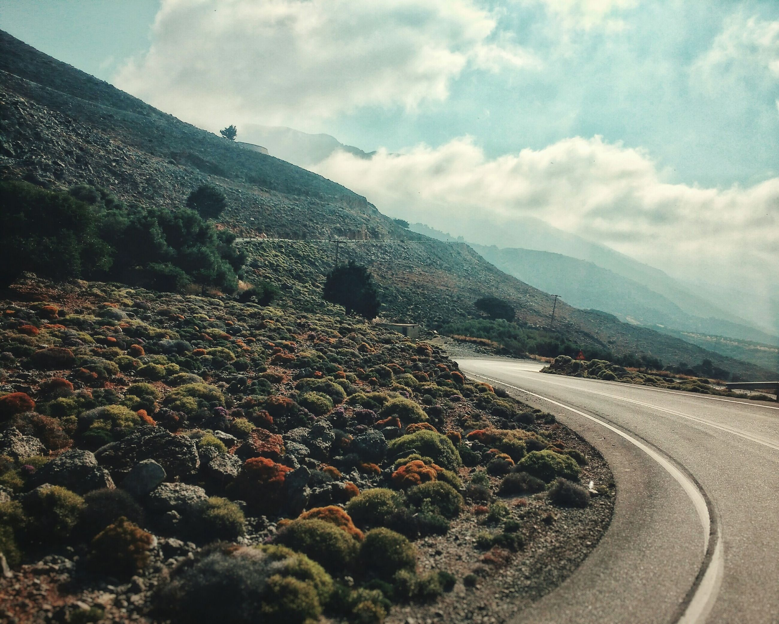 mountain, road, landscape, no people, sky, day, nature, mountain range, outdoors, scenics, tranquil scene, transportation, beauty in nature, winding road, pebble beach
