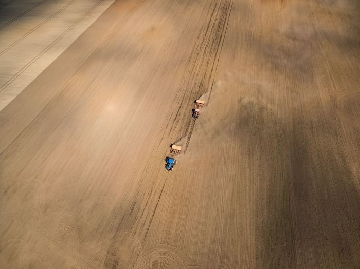 High Angle View Aerial View Agriculture Summer Transportation Farm Crop  Agricultural Machinery Gold Colored Rural Scene Growth Backgrounds Cereal Plant Outdoors Combine Harvester One Person Day Nature