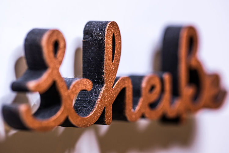 Shit! Scheiße ShitHappens Alphabet Brown Capital Letter Close-up Communication Focus On Foreground Selective Focus Shit! Still Life Studio Shot Text Western Script White Background Wood - Material