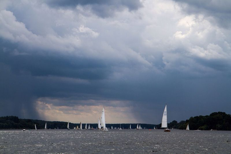 Clouds Rain Sailing Wannsee Berlin Cloud - Sky Sky Water Sea Architecture Outdoors Waterfront Day Scenics Built Structure Sailboat Nature No People Nautical Vessel Beach Beauty In Nature Tree Horizon Over Water Building Exterior City