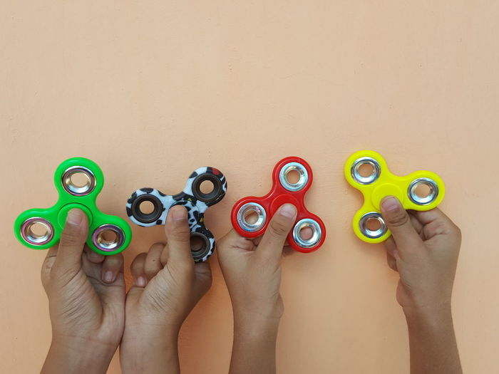 Play fidget spinner together Human Body Part Adult People Mid Adult Human Hand Togetherness High Angle View Beige Background Adults Only Variation Women Cooperation Sand Only Women Beach Young Adult Young Women Day Teamwork Fidget Spinner EyeEm Best Shots