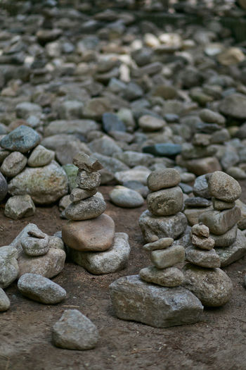 Meditative artistic skill of stone stacking Stone Pebble Stone - Object Large Group Of Objects Solid No People Rock Stack Balance Close-up Abundance Selective Focus Backgrounds Day Still Life Zen-like Indoors  Full Frame Textured  Art And Craft Meditation Artistic Skill  Stacking
