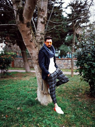 Tree Full Length Fashion Wool Grass Posing Head And Shoulders Low Section Thoughtful Wearing Haute Couture Hiker Footwear Blooming Warm Clothing Friend Growing Shoe Scarf