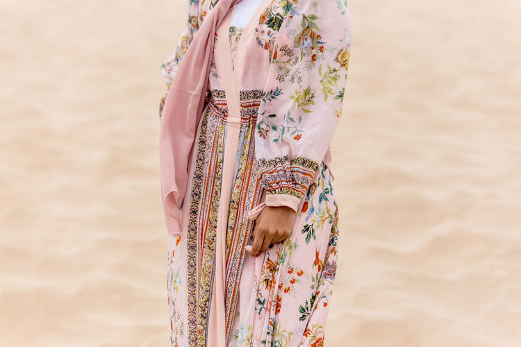 fashionista Fashion Middle East Adult Beach Clothing Day Fashion Model Fashion Photography Floral Pattern Focus On Foreground Human Body Part Human Limb Land Leisure Activity Lifestyles Midsection Outdoors Pattern People Real People Sand Standing Traditional Clothing Women