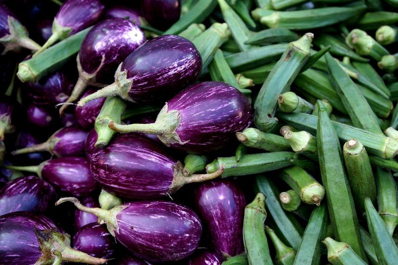 High angle view of eggplant and okras at market stall