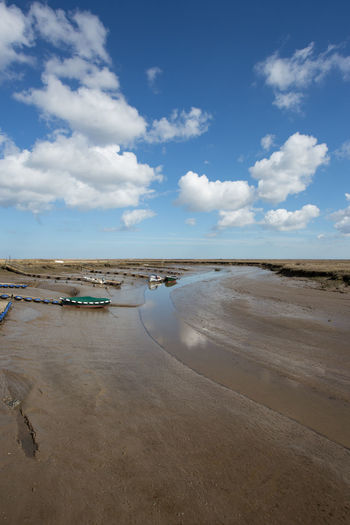 Morton Creek, Norfolk, England at low tide Copy Space Low Tide Zone Morston Creek Norfolk Uk Beach Beauty In Nature Blue Cloud - Sky Day Horizon Land Low Tide Mud Nature No People Non-urban Scene Outdoors Reflections In The Water Salt Flat Sand Scenics - Nature Sea Sky Tranquil Scene Water