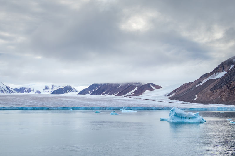 Panoramic view of glacier against sky in nunavut, canadian arctic.