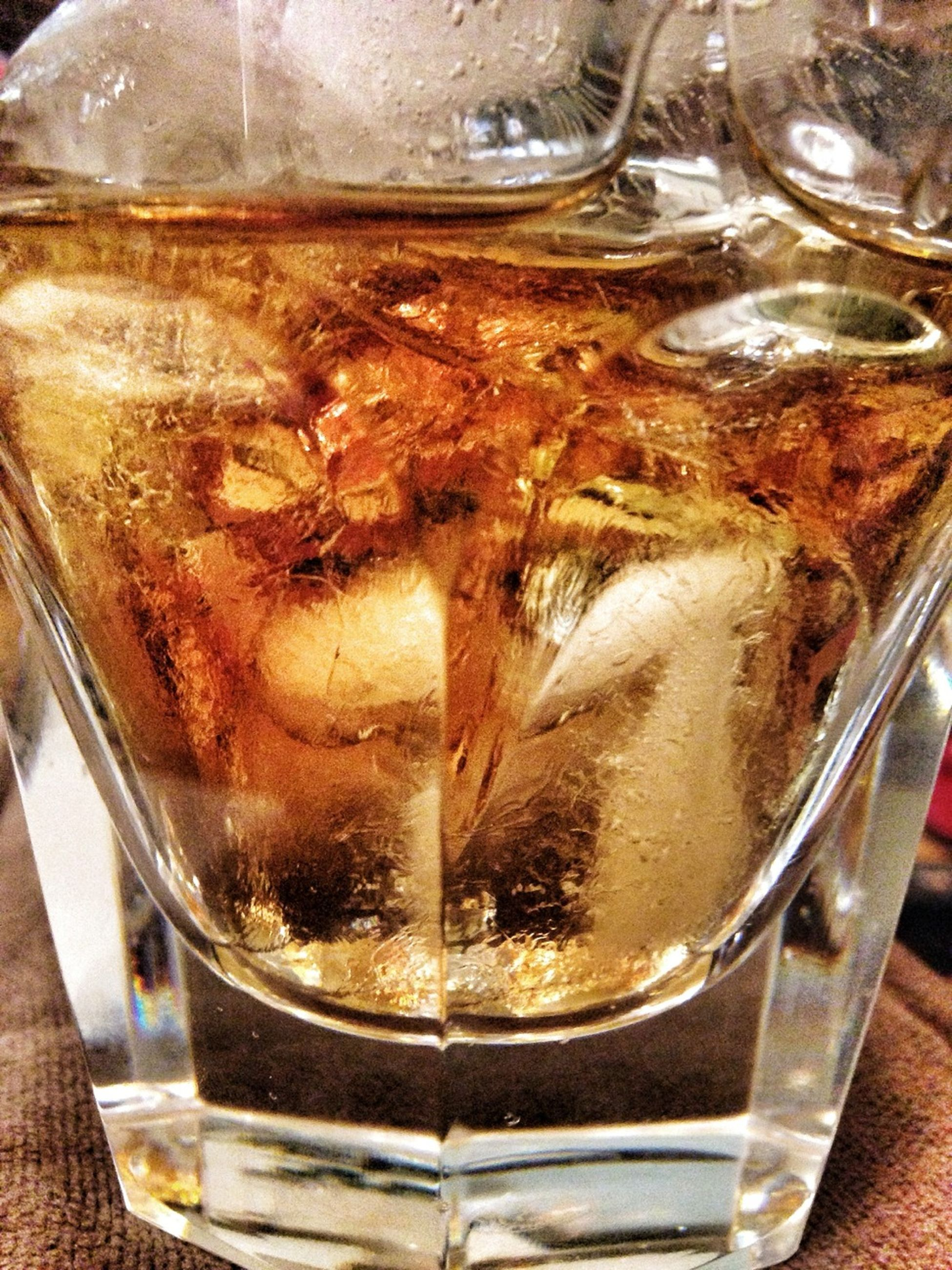 glass - material, transparent, food and drink, indoors, drinking glass, close-up, refreshment, drink, freshness, glass, ice, ice cube, cold temperature, water, alcohol, no people, still life, high angle view, window, reflection